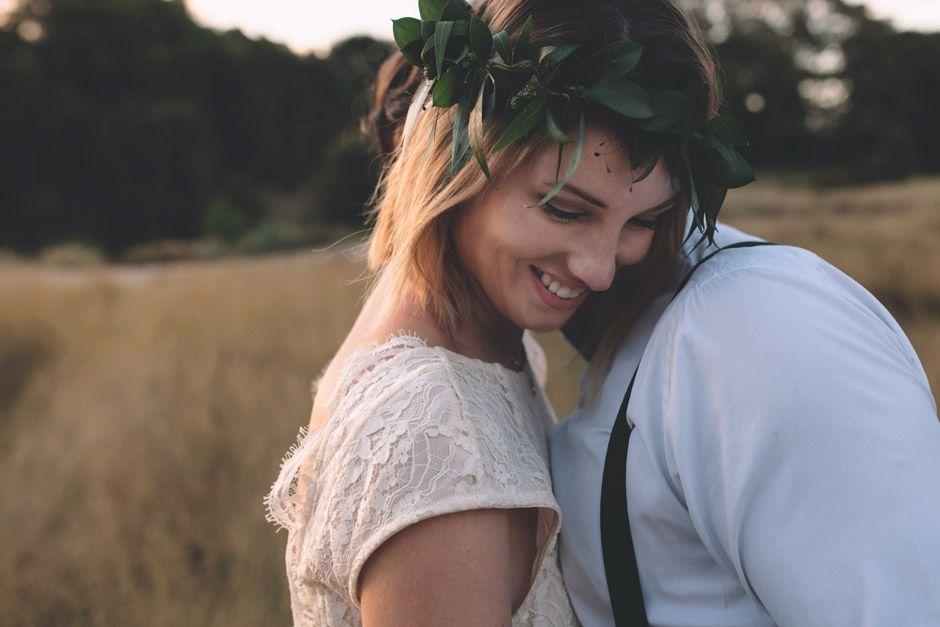 bride-smiling-on-grooms-shoulder